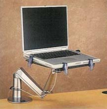 Monitor and laptop arms. Pull your laptop over in front of you when you need it, and push it away when you want.