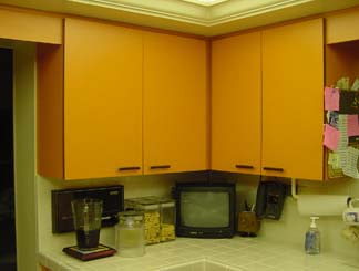 Before photo of a bank of cabinets