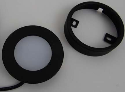 Loox 2020 LED light shown with optional surface mount ring